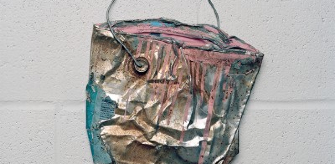 Image of a Paint Bucket hanging o a wall