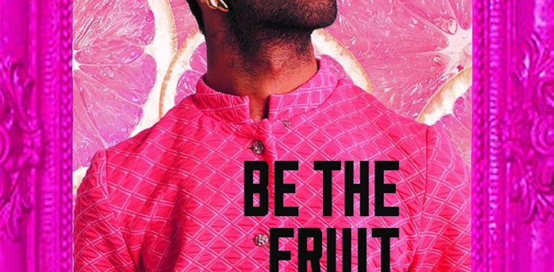 Image of a male wearing a pink T-shit with the words be the fruit you want to eat printed on the front