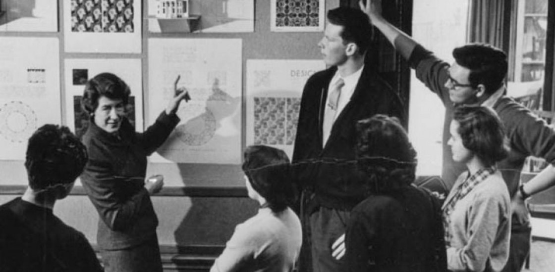 image of students looking at artwork mounted on a wall