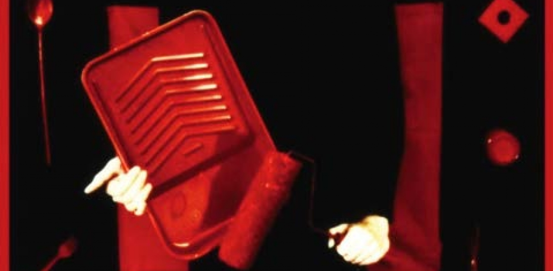 image of a female figure dressed in black with a red paint tray and roller