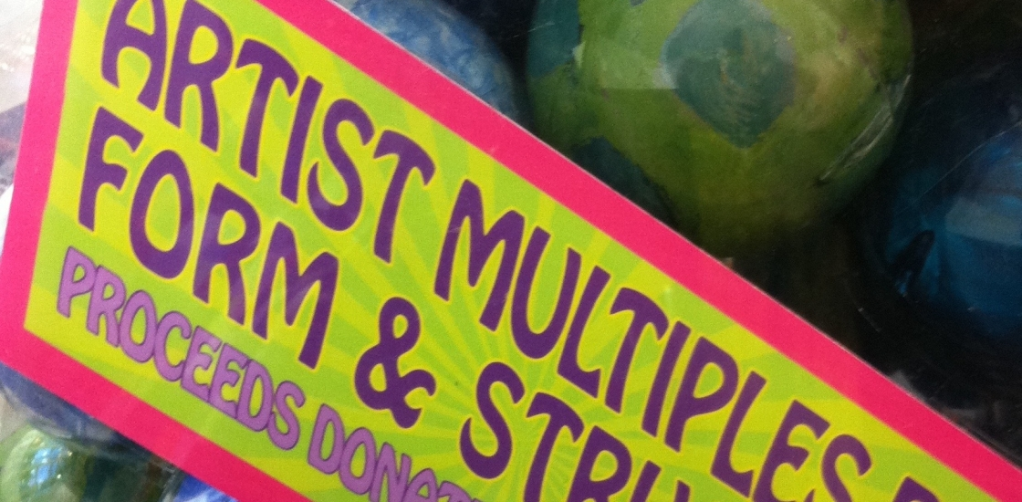 close up photo of artist multiples in plastic gumball spheres
