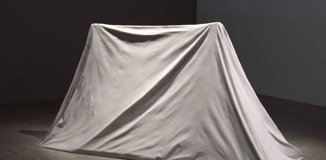 photo of a tent sculpted of marble