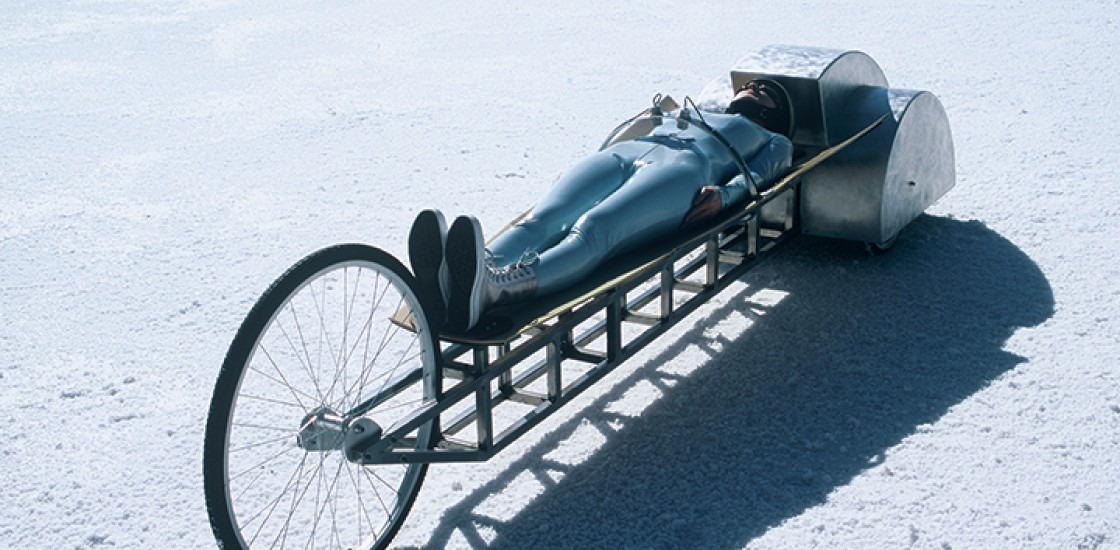 body lying down on wheeled vehicle