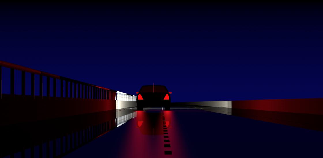 Image of a car's brake lights at night