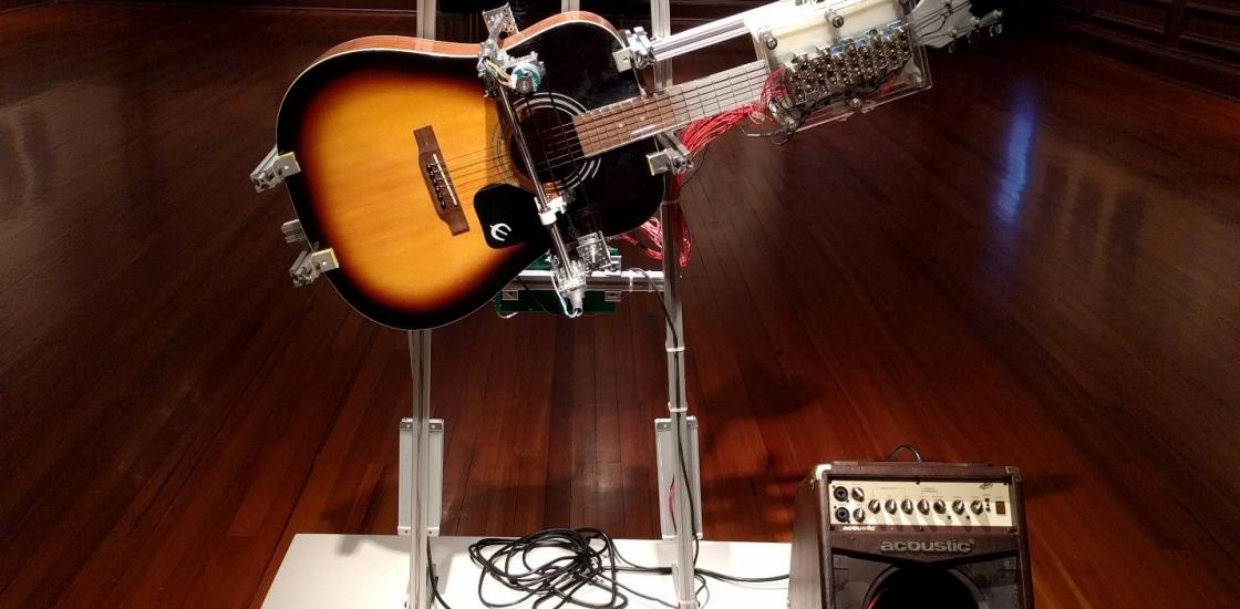 photo of guitar machine robot