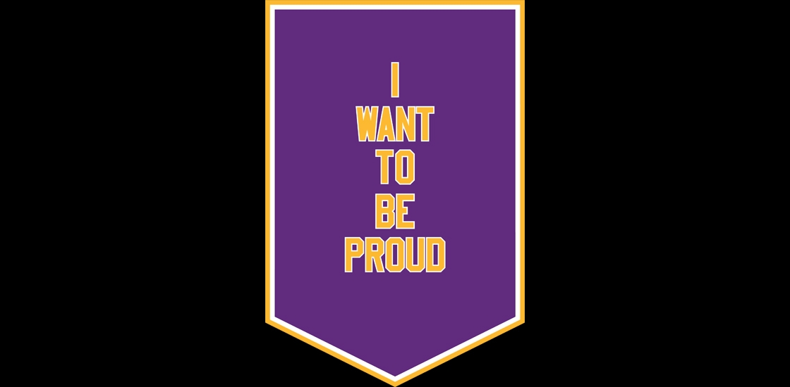 """Banner saying """"I want to be proud"""""""