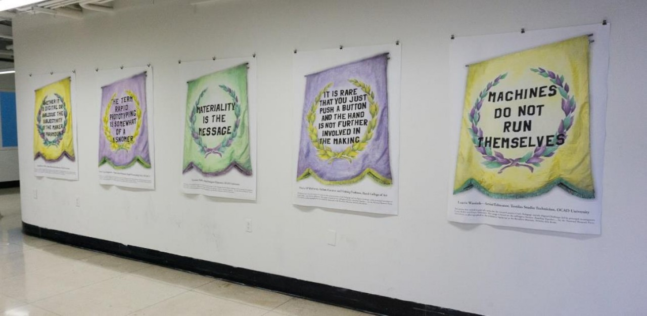 Photograph of CPDC posters exhibited on a wall at OCAD U.