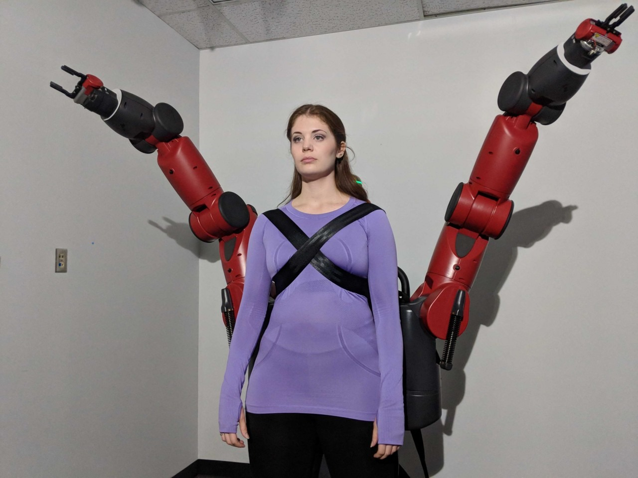 Ac actor performing as a cyborg with additional arms