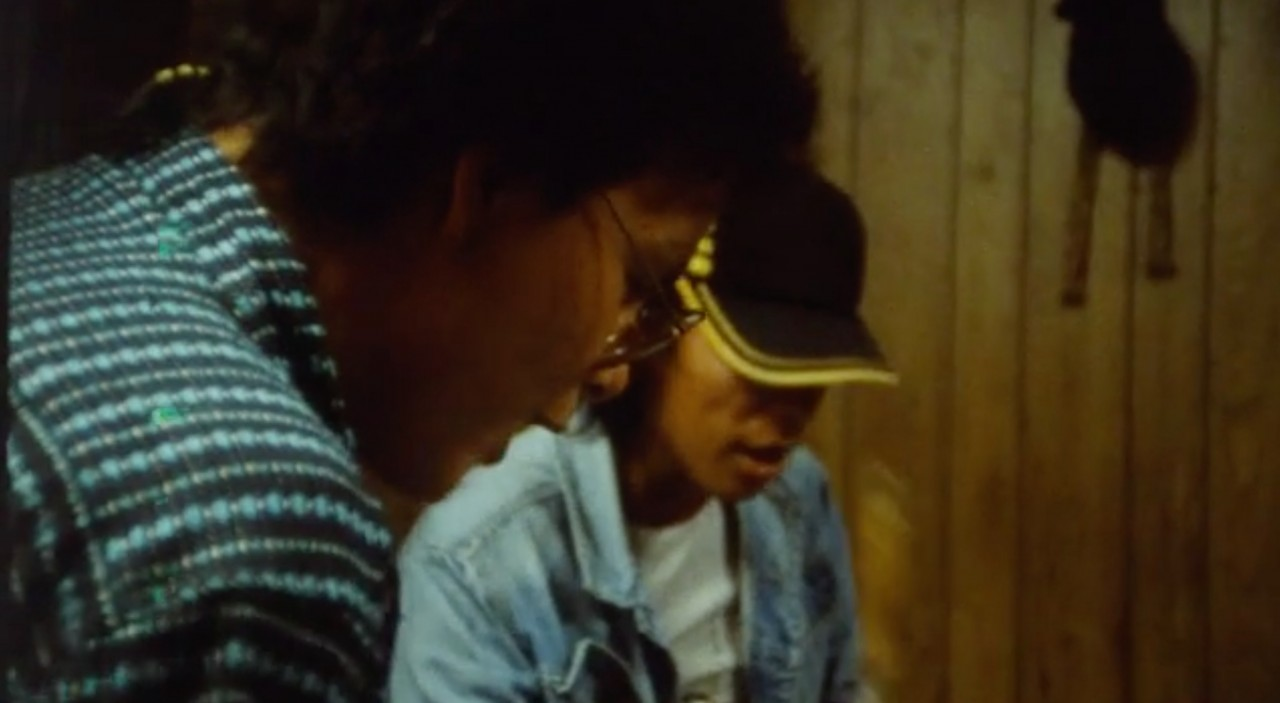 "Video still from ""Lac La Croix (1998)"" of two men"