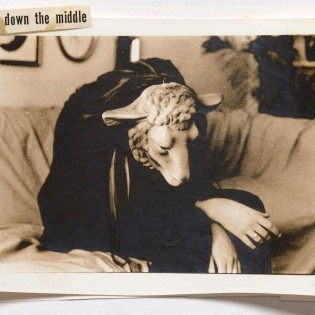 photo of a seated person in a sheep mask