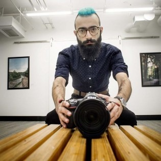 photo of Ishkhan Ghazarian with camera