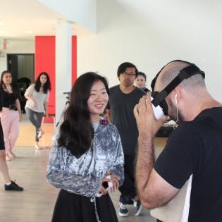 MDes student, Bijun Chen presenting her prototype to industry partners