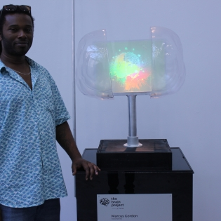 Marcus A. Gordon and his sculpture: Holomentis