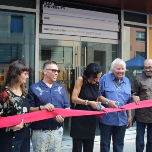 Ribbon Cutting Ceremony in front of gallery