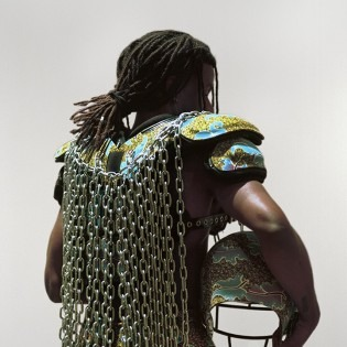 Untitled (No Fields), Repurposed football gear, African wax print, Chain, Black astroturf, Nikes, Image provided by the artist