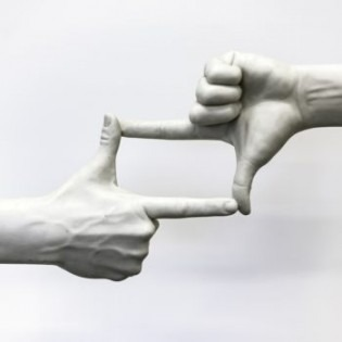 two hands creating a frame shape