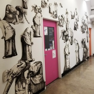 wall installation of illustrated workers