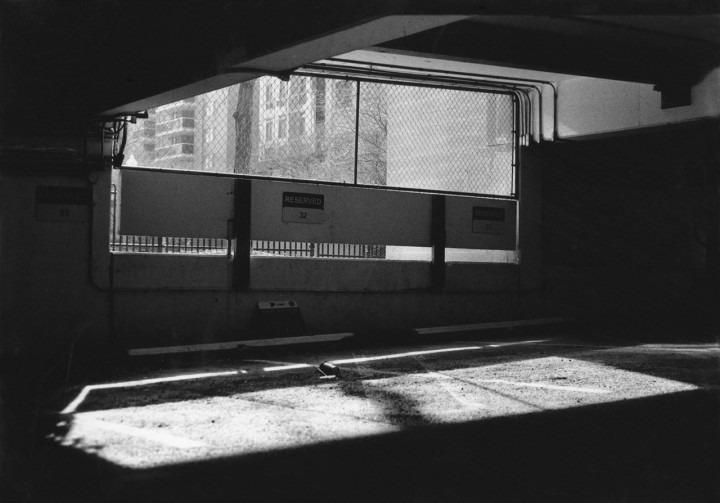 B&W  photo of window in an empty room