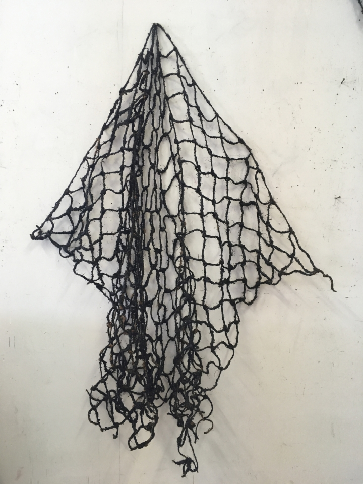 Image of a net on a white wall