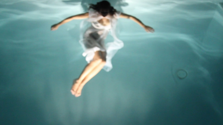 Photograph of a woman floating in water