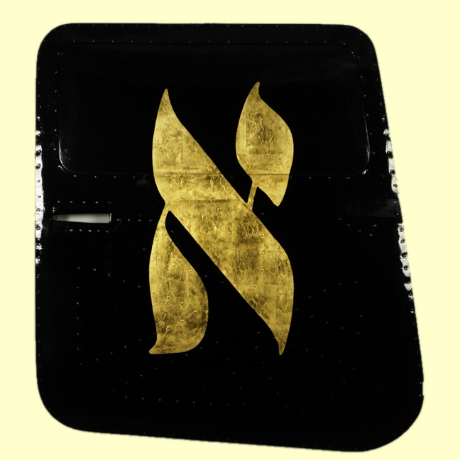 gold symbol on black background