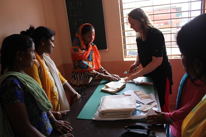 Sarah Tranum discussing the CleanCube project with local women