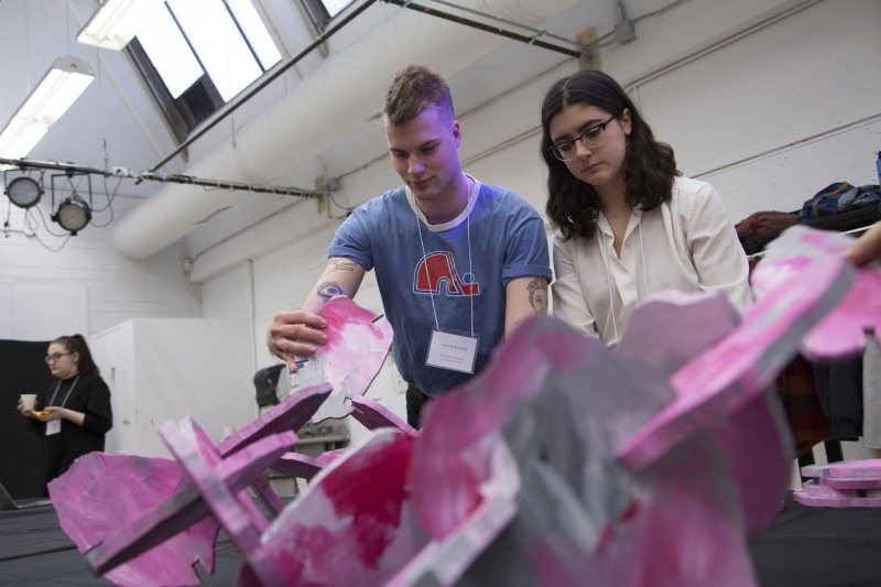 Two students working on a sculptural piece