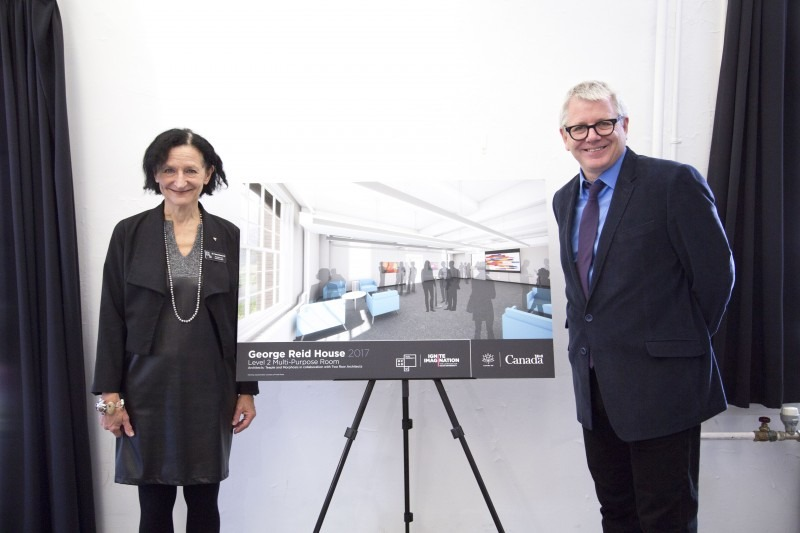 Sara Diamond and Adam Vaughan stand next to rendering of renewed space