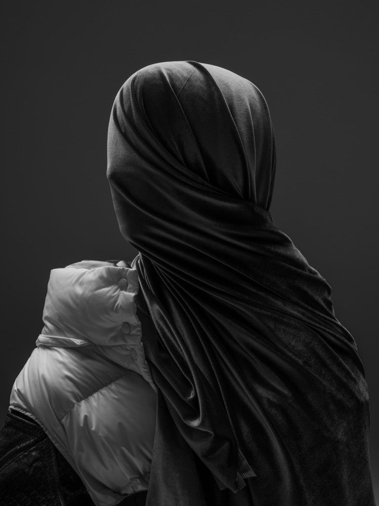 black and white photo of face wrapped in fabric