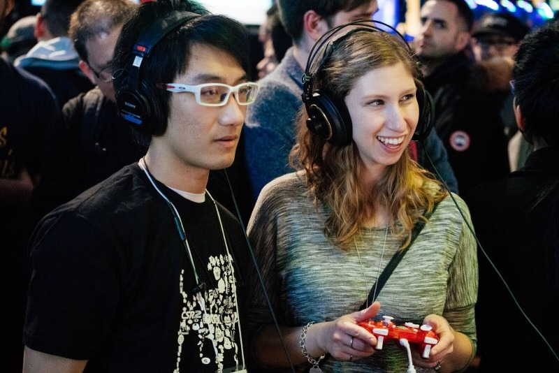 a man and a woman playing a video game