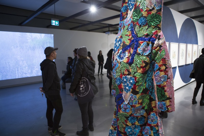 A tall colourful, beaded and sequined costum