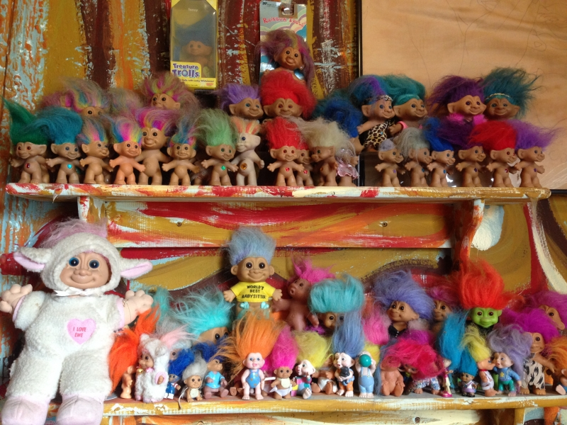 Picture of troll dolls lined up on a shelf