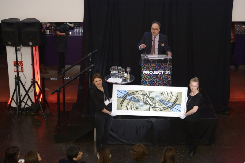 Photo of Auctioneer with artwork
