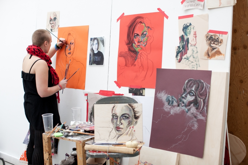 Woman painting portraits