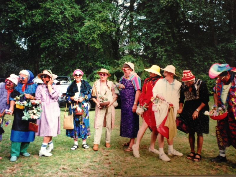 Group of people in hats and colourful clothes