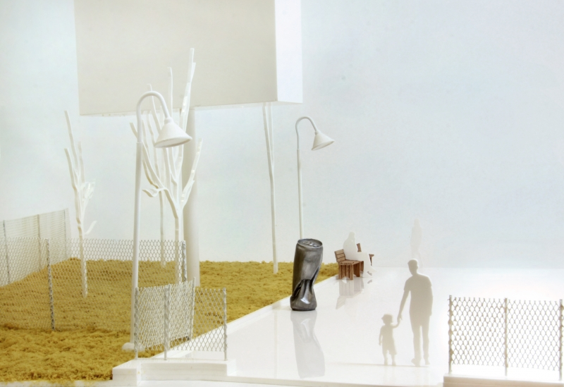 photo of sculptural maquette featuring a large crushed can sculpture
