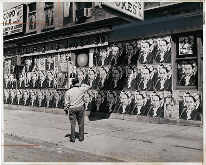 Archival photo of a person looking at posters of Prime Minister Pierre Trudeau, 1968