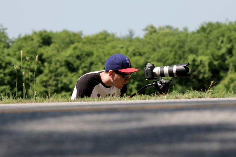 Image of Tom Briggs with camera, shooting bike race