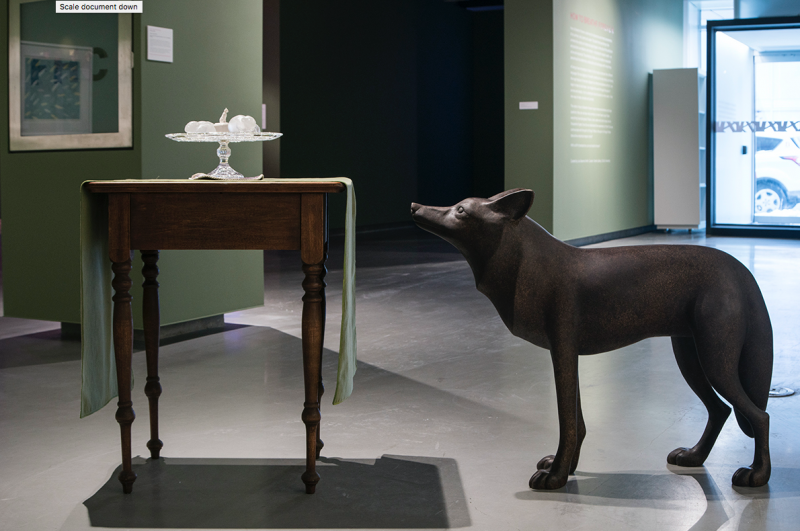 """Installation view: Mary Anne Barkhouse; Treats for Coyote; 2018; bronze, wood, velvet, glass and porcelain; 74"""" x 22"""" x 42"""". Pho"""