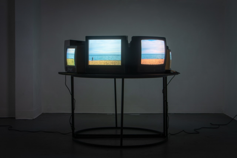 photo of tv's on stands