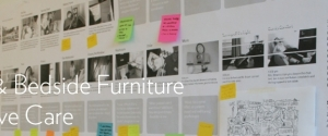 Photograph of project process work posted on a wall with overlaid text reading: Comfort & Bedside Furniture for Palliative Care