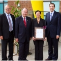 Robert Montgomery, Monte Kwinter, Sara Diamond and MPP John Milloy with plaque