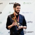 bearded young man, Ryan Mason, holding a trophy